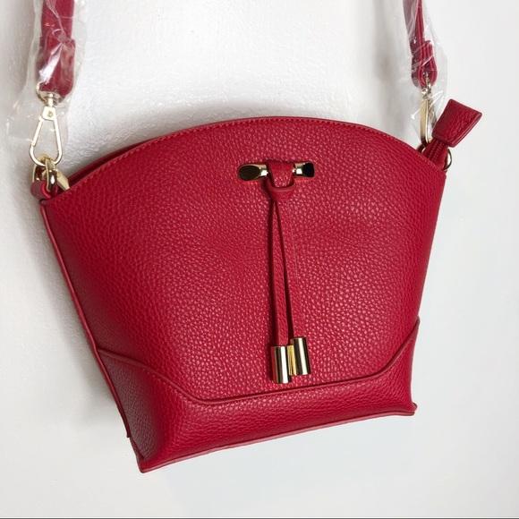 Charming Charlie Handbags - Charming Charlie Ruby Red Pebble Crossbody Bag